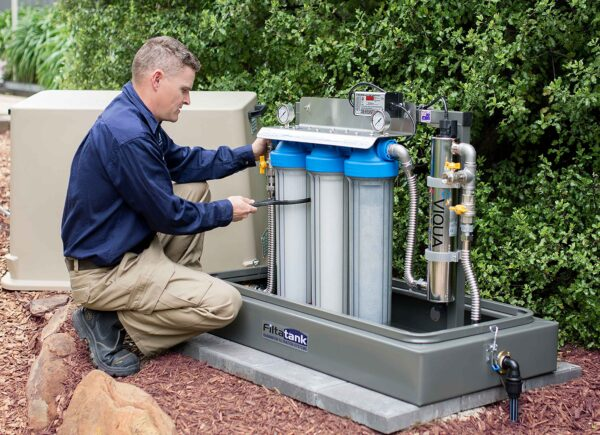 Triple-cartridge-free-standing-rainwater-filtration-system-with-ultraviolet-sterilisation-servicing-picture